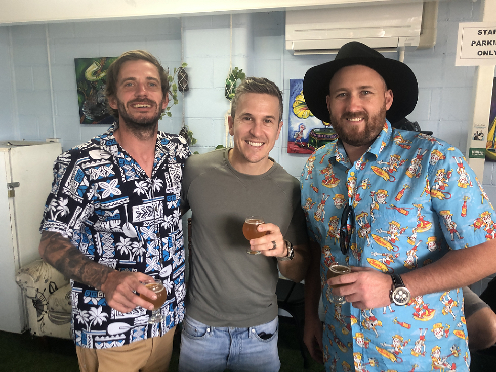 three mates enjoying beers at Happy Valley Brewing Co on a Northern Exposure brewery tour